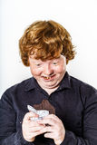 Happy red-haired boy with chocolate bar Royalty Free Stock Image