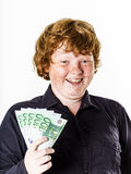 Happy red-haired boy with money Stock Images