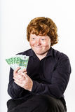 Happy red-haired boy with money Royalty Free Stock Photos