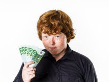 Happy red-haired boy with money Stock Photo