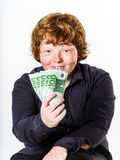 Happy red-haired boy with money Stock Photography