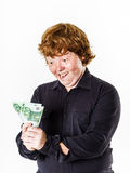 Happy red-haired boy with money Royalty Free Stock Image