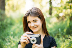 Happy Red-haired Caucasian Girl Young Woman Photographer Taking Pictures The Old Retro Vintage Film Camera Stock Photography