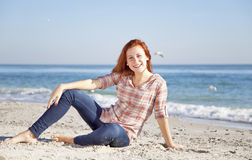 Happy red-haired girl at the beach. Royalty Free Stock Photo