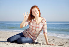 Happy red-haired girl at the beach. Royalty Free Stock Image