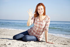 Happy red-haired girl at the beach. Stock Images