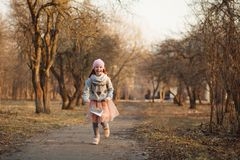 Happy red-haired girl with freckles in a sunny park. Spring or Autumn. Happy carefree childhood royalty free stock image