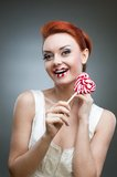 Happy red-haired girl holding candy Royalty Free Stock Photos