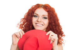 Happy red haired girl holding hat Stock Image