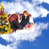 Happy red-haired girl with phone and gifts Royalty Free Stock Image