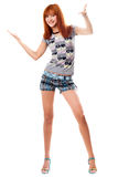 Happy red-haired girl in a t-shirt and shorts Stock Photography