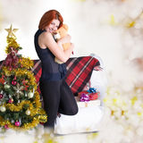 Happy red-haired woman with gift Royalty Free Stock Photos