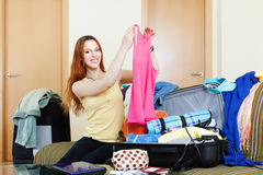 Happy red-haired woman with luggage. In home going on holiday Stock Photos