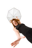 Happy red haired woman with umbrella. Happy  red haired woman in black dress with umbrella Royalty Free Stock Photo