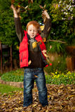 Happy red haired young preschool boy playing in au Stock Images