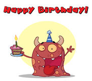 Happy red monster celebrates birthday Royalty Free Stock Photography