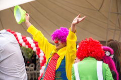 Happy red nosed clown. A happy clown with his hat up performs his skills  in a children& x27;s show Stock Photo