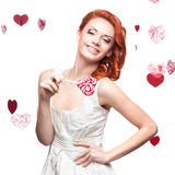 Happy red woman holding lollipop Royalty Free Stock Photos