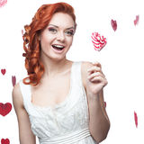 Happy red woman holding lollipop Stock Image