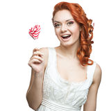 Happy red woman holding lollipop Royalty Free Stock Photography