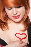 Happy redhair girl with heart love symbol Royalty Free Stock Photo