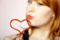 Happy redhair girl with heart love symbol Royalty Free Stock Photography