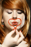 Happy redhair girl with heart love symbol Royalty Free Stock Image