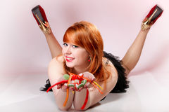 Happy redhair woman with gummy candy Royalty Free Stock Images