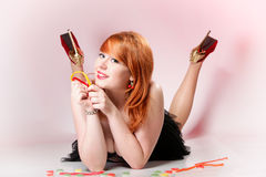 Happy redhair woman with gummy candy Stock Photography