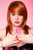 Happy redhair woman with lollipop candy Royalty Free Stock Photo