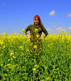 Happy redhead camouflage woman yellow fields Stock Image