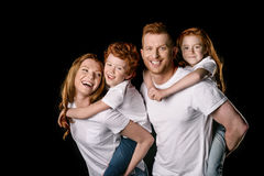 Happy redhead family in white t-shirts smiling Stock Image
