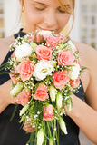 Happy redhead girl. Smelling bridal bouquet Stock Images