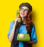 Happy redhead girl with dial phone Stock Image