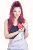 Happy redhead girl with gift heart shaped box. With a ribbon Stock Image