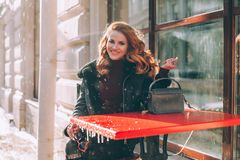 Happy Redhead Girl Sitting in Street Cafe stock image