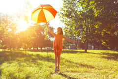 Happy redhead girl with umbrella stock images