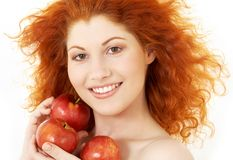 Happy redhead with red apples Stock Photo