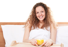 Happy redhead woman in bed Stock Photos