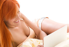 Happy redhead woman with laptop computer Stock Photo