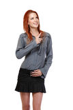 Happy redhead woman pointing at copyspace Royalty Free Stock Photography