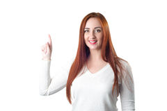 Happy redhead woman pointing up with her finger Stock Photography