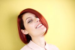 Happy redhead woman smiling Stock Image