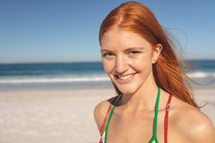 Happy redhead woman standing on the beach. Portrait of Caucasian happy redhead woman standing on the beach stock photos