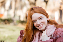 Happy redhead woman walking in park Royalty Free Stock Photography
