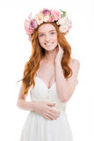 Happy redhead woman with wreath from flowers on head Royalty Free Stock Photography