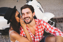 Happy relathionship couple whispering royalty free stock photo