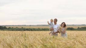 Happy relationship, young family walking together stock images