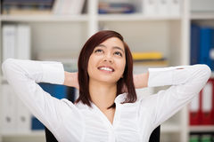 Happy relaxed Asian woman daydreaming Stock Photo