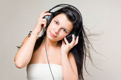 Happy relaxed brunette listening to music. Stock Photo